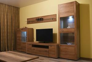 Télévision ou salle de divertissement dans l'établissement Apartments Victoria