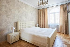 Кровать или кровати в номере Spa Centrе Apartments Kirova