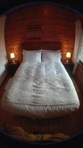 A bed or beds in a room at Terrazas del Palena