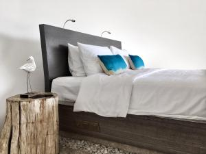 A bed or beds in a room at The Cloud Unique Beachfront Villa