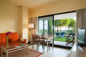 A seating area at Precise Resort El Rompido-The Club