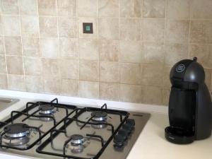 O bucătărie sau chicinetă la Chibia Apartment