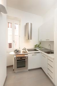 A kitchen or kitchenette at Margana Tower