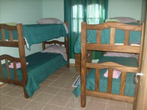 Una cama o camas cuchetas en una habitación  de Aires del Montura
