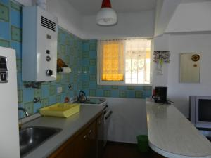 Una cocina o kitchenette en Edificio Paulamar