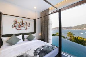 A bed or beds in a room at Jirana Patong