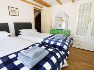 A bed or beds in a room at Weardale Cottage, Bishop Auckland