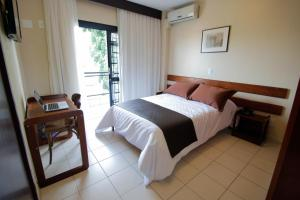 A bed or beds in a room at Apartamento Morato X