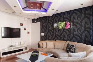 Ein Sitzbereich in der Unterkunft Appartement La Bagatelle