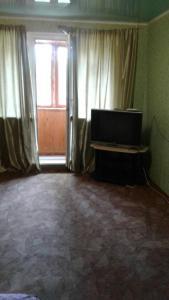 A television and/or entertainment centre at Апартаменты на Островского,16Б