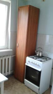 A kitchen or kitchenette at Апартаменты на Островского,16Б