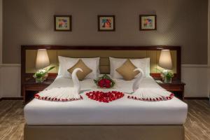 سرير أو أسرّة في غرفة في أجنحة بودل ابها