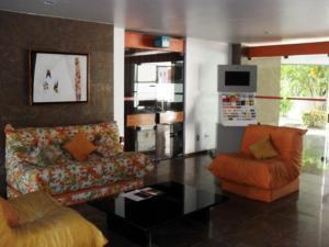 A seating area at Flat Luxo Bem Localizado No Bairro Da Barra Salvador