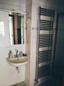 A bathroom at Luciano apartament