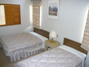 A bed or beds in a room at Hakuba Royal Suites