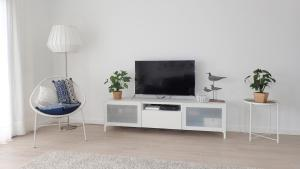 A television and/or entertainment center at Silver Breezes Apartment