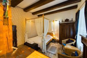 Cama ou camas em um quarto em Kron Studio Kalista