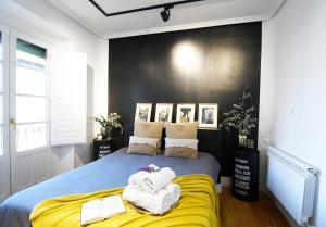 Cama o camas de una habitación en Apartment iDesign 2