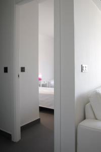 A bed or beds in a room at Alicante CS