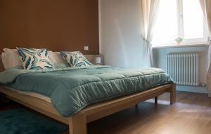 Letto o letti in una camera di Leoncino Apartment 2