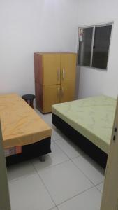 Cama o camas de una habitación en Casa temporada Mosqueiro