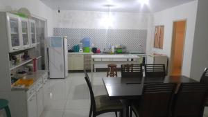 Una cocina o zona de cocina en Casa temporada Mosqueiro