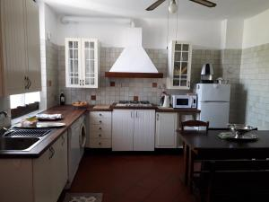A kitchen or kitchenette at L'Antica Corte