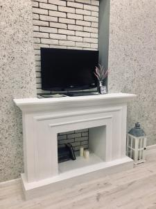A television and/or entertainment center at Alter House Apartment