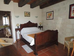 Un ou plusieurs lits dans un hébergement de l'établissement Gite Les Hortalis