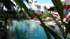 The swimming pool at or near Amaya Cottage Ubud