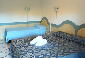 A bed or beds in a room at Residence Porto Mannu