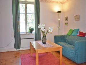 A seating area at Holiday home Runstorps Säteri Kimstad