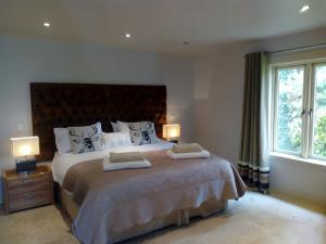A bed or beds in a room at Luxury Holiday Home Bantry
