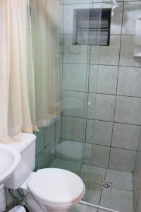 Um banheiro em Hospedagem Clair