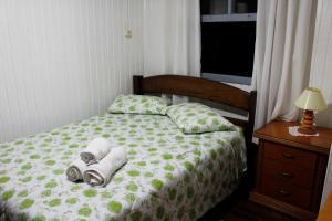 Cama ou camas em um quarto em Hospedagem Clair