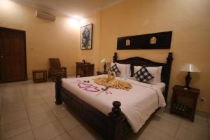 Letto o letti in una camera di Capung Cottages