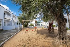 Children's play area at Apartaments Cales de Ponent