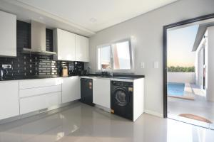 A kitchen or kitchenette at Paradise Terrace House