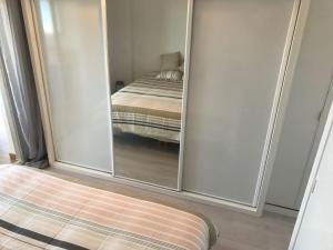 A bed or beds in a room at OceanTerrace Apartment Esmeralda