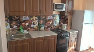 A kitchen or kitchenette at 118 улица Московская