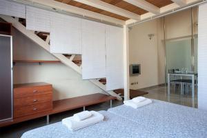 Télévision ou salle de divertissement dans l'établissement AB Paseo de Gracia Apartments