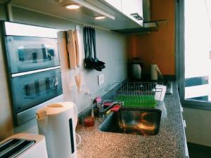 Una cocina o kitchenette en BarilocheCentro I