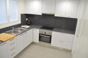 A kitchen or kitchenette at AD Hostel Rooms Tarragona