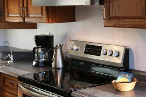 A kitchen or kitchenette at Spacious Cottage 10 Minutes from Wineries and Beach