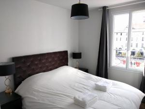 A bed or beds in a room at Holiday Apartment Val d'Europe