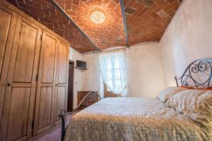 Letto o letti in una camera di Villa Ghiandai