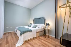 A bed or beds in a room at iloftmalaga Casapalma