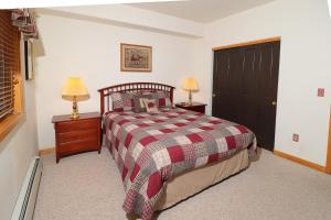 A bed or beds in a room at Keystone Resort by Rocky Mountain Resort Management