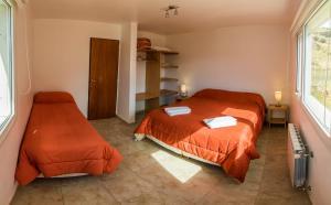 Una cama o camas en una habitación de Las Agachonas Apart