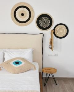 A bed or beds in a room at Angelos Boutique Suites